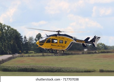 AKRON, OHIO/USA - SEPT 9, 2017: A Metro Life Flight Eurocopter MBB-BK 117 C-2  helicopter at Props and Pistons Airshow taking place at the Akron Fulton International Airport