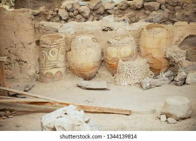 Akrotiri, Greece - August 01, 2012: Ruins of the ancient buildings and decorated pottery from the Minoan Bronze Age at the archaeological site in Akrotiri, Greece.