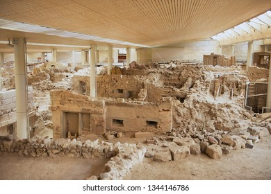 Akrotiri, Greece - August 01, 2012: Ruins of the ancient buildings from the Minoan Bronze Age at the archaeological site in Akrotiri, Greece.