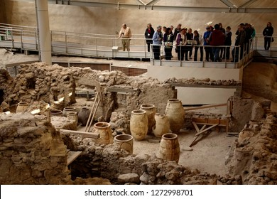 AKROTIRI, SANTORINI - DEC 2, 2018 - Tourists exploring the  ancient ruins of Akrotiri, Santorini, Greece