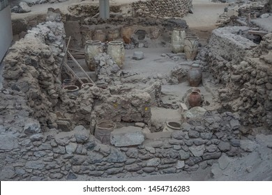 Akrotiri, Santorini, Greece: Ancient urns found at the archaeological site of the Minoan Bronze Age settlement, first excavated in 1867.