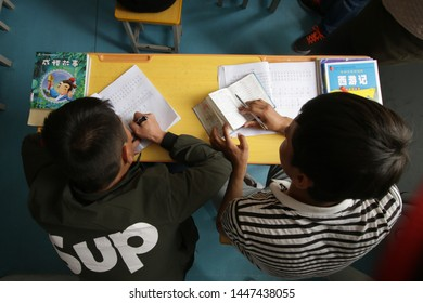 AKSU, CHINA - APRIL 24 2019. Uigurs learn Chinese language at reeducation camp (vocational skills training center)  in Wensu County, Aksu prefecture in Xinjiang