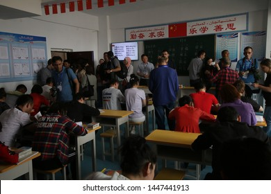 """AKSU, CHINA - APRIL 24 2019. Uigurs learn Chinese language at reeducation camp in Xinjiang. Journalists were able to visit the """"vocational training center"""" in Wensu County, Aksu Prefecture in Xinjiang"""