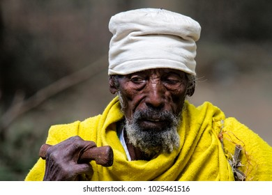 Aksum, Ethiopia, December 12, 2010:  old pilgrim in the courtyard of the  Church of Our Lady Mary of Zion  in Aksum.