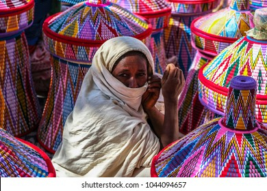 AKSUM, ETHIOPIA - JANUARY 13: Ethiopian women selling baskets in the Aksum basket market on January 13, 2018 in Aksum, Ethiopia.
