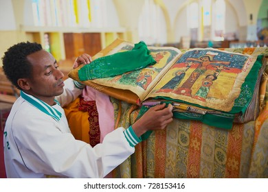 AKSUM, ETHIOPIA - JANUARY 25, 2010: Unidentified man demonstrates ancient Bible in the church of Our Lady Mary of Zion, the most sacred place for all Orthodox Ethiopians in Aksum, Ethiopia.