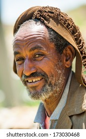AKSUM, ETHIOPIA - SEP 24, 2011: Unidentified Ethiopian old man in a hat smiles in Ethiopia, Sep.24, 2011. People in Ethiopia suffer of poverty due to the unstable situation