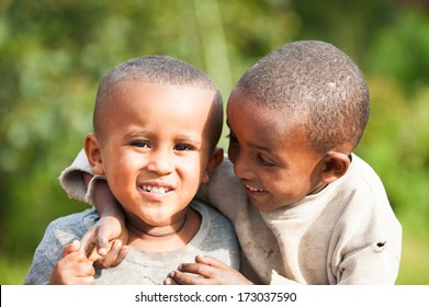AKSUM, ETHIOPIA - SEP 27, 2011: Two unidentified Ethiopian little boys play together in Ethiopia, Sep.27, 2011.Children in Ethiopia suffer of poverty due to the unstable situation