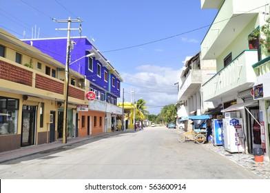 Akumal, Mexico - 8 January 2017: Colorful buildings in a small beach-front tourist resort, Pueblo Akumal - Riviera Maya area on the Yucatan Peninsula.