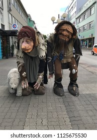Akureyri, Iceland - July 11, 2017: Beautiful buildings and streets in Akureyri city, Iceland. Two troll dolls with a polar bear. Trolls are legendary figures in Icelandic mythology.