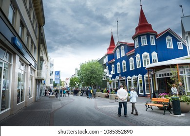 Akureyri, Iceland - July 22, 2017: Beautiful buildings and streets in Akureyri city, Iceland, Akureyri is a city at the base of Eyjafjordur Fjord in northern Iceland.