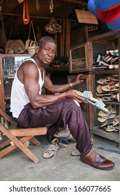 AKWA IBOM, NIGERIA, JUNE 27: A shoemaker displays his work in his shop on 27 June, 2005 in the area of Akwa Ibom in the south of Nigeria.