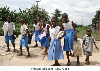 AKWA IBOM, NIGERIA, JUNE 27: A happy group of schoolchildren leave school to work in the fields on 27 June, 2005 in the area of Akwa Ibom in the south of Nigeria.