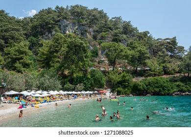 Akyaka, Mugla, Turkey - July 30, 2016. Cinar beach near Akyaka village in Mugla province of Turkey, with people.