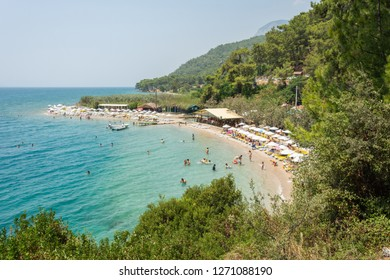 Akyaka, Mugla, Turkey – July 30, 2016. Cinar beach near Akyaka village in Mugla province of Turkey, with people.