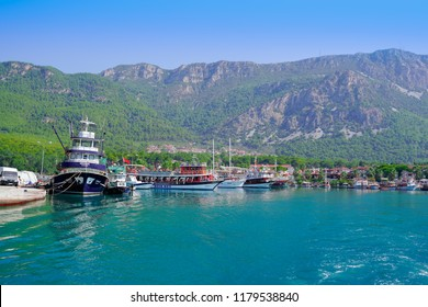 Akyaka, Mugla/Turkey - August 15 2018: Daily tours, Akyaka village and mountain in the background.