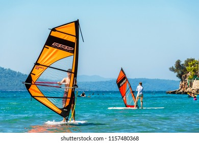 Akyaka, Turkey -August 13, 2018 : People are windsurfing in Gokova Gulf of Turkey.