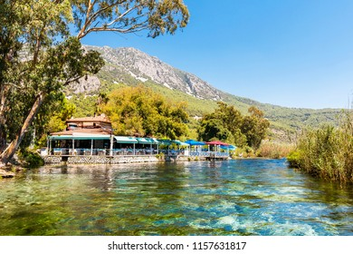 Akyaka, Turkey - August 13, 2018 : People are resting in a restaurant on Azmak River in Akyaka Village