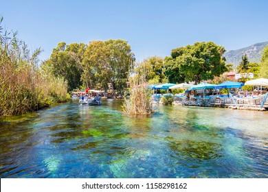 Akyaka, Turkey - August 13, 2018 : People are taking tour on Azmak River in Akyaka Village
