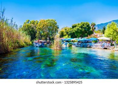 Akyaka, Turkey - August 14, 2018 : People are taking tour on Azmak Stream in Akyaka Village. Akyaka is popular tourist destination in Turkey.