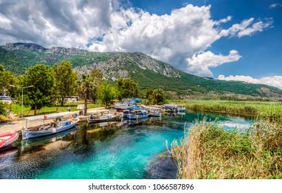 Akyaka, Turkey - May 30, 2014 : People are taking tour on Azmak Stream in Akyaka Village. Akyaka is popular tourist destination in Turkey.