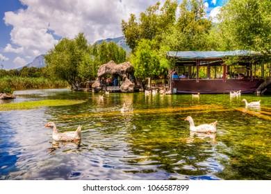 Akyaka, Turkey - May 30, 2014 : People are taking lunch on Azmak Stream in Akyaka Village. Akyaka is popular tourist destination in Turkey.