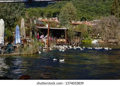 Akyaka, Turkey - november 14, 2014 : People are taking tour on Azmak Stream in Akyaka Village. Akyaka is popular tourist destination in Turkey.