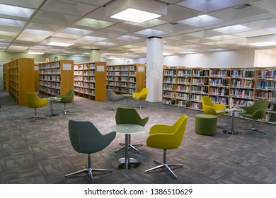 Al Ain, UAE - March 20, 2019. Empty library with tables and chairs in the middle for the reader