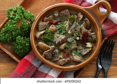 Al ajillo gizzard with mushroom and garlic