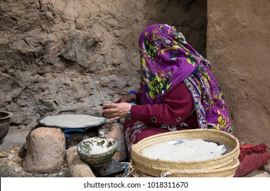 Al Hamra Oman, February 2nd, 2018: omani woman making bread in the kitchen of a traditional house