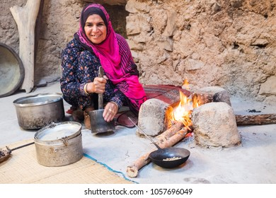 AL Hamra /Sultanate of Oman- Feb 24 2018: Omani woman in traditional kitchen roasting coffee beans at Bait al Safah, Al Hamra.