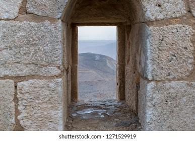 Al Jaya, Jordan, December 06, 2018 : The loophole on the corner tower in the medieval fortress Ash Shubak, standing on a hill near Al Jaya city in Jordan