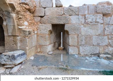 Al Jaya, Jordan, December 06, 2018 : The platform with loophole on the corner tower in the medieval fortress Ash Shubak, standing on a hill near Al Jaya city in Jordan