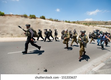 AL KHADER, PALESTINIAN TERRITORY - MAY 14: Israeli soldiers clash with Palestinian youth near the village of Al Khader, West Bank, May 14, 2013.