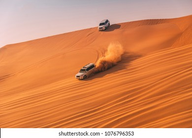 AL KHATIM DESERT-DUBAI/UNITED ARAB EMIRATES - MARCH, 2018: Dune bashing with a 4x4 jeep