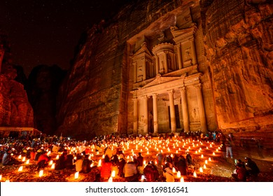 Al Khazneh in the ancient city of Petra, Jordan at night. It is known as The Treasury. Petra has led to its designation as a UNESCO World Heritage Site.