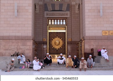 AL MADINAH, KINGDOM OF SAUDI ARABIA- NOV 28, 2016 : Group of muslims at the entrance of Nabawi Mosque. Nabawi mosque is the 2nd holiest mosque in Islam.