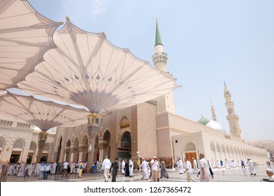 AL MADINAH , SAUDI ARABIA-August 30, 2018: Muslim pilgrims visiting the beautiful Nabawi Mosque, and green dome of a mosque taken off the compound. masjid Al Nabawi minaret and green dome in Madinah.