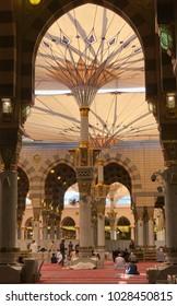 AL MADINAH, SAUDI ARABIA-JANUARY 18, 2018: Muslim pilgrims pray and read Quran inside Masjid Nabawi in Medina, Saudi Arabia.