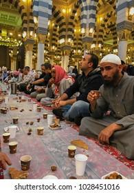 AL MADINAH, SAUDI ARABIA-JANUARY 18, 2018:  Unidentified Muslim men break fast at dawn inside Nabawi mosque in Medina, Saudi Arabia.