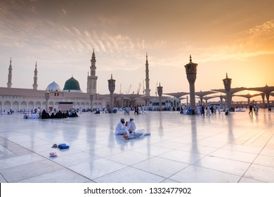 AL MADINAH , SAUDI ARABIA-Sep 3, 2018: Muslim pilgrims visiting the beautiful Nabawi Mosque, and green dome of a mosque taken off the compound. masjid Al Nabawi minaret and green dome in Madinah.