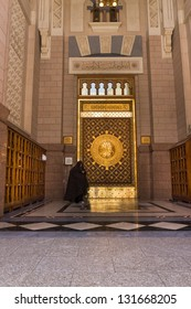 AL MADINAH,SAUDI ARABIA (S.A.)-FEB.17:Unidentified Moslem woman walks by Umar Al Khattab Gate at Masjid Nabawi in Al Madinah, S.A. on February 17, 2012.Nabawi Mosque is the 2nd holiest mosque in Islam