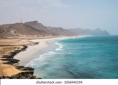 Al Mugsail Beach, Salalah, Sultanate of Oman. Al-Mughsail Beach boasts six uninterrupted kilometers (four miles) of white sand, complete with picnic shelters and frankincense trees.
