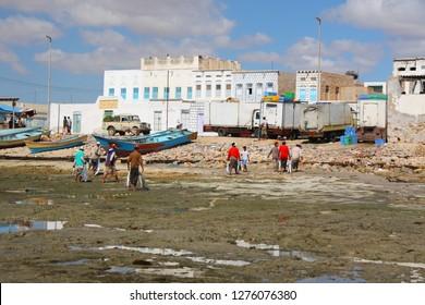 AL MUKALLA, YEMEN, DECEMBER 2008: unidentified men come back from fishing on December 26, 2008 in Al Mukalla.