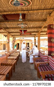 Al Qattara Souq, Al Ain, United Arab Emirates- 12th Nov 2016- Arab friends in White Kandura  gather in a souq. Heritage and Hospitality in Majilis/meeting place for coffee.