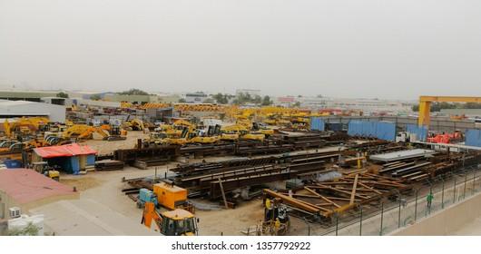 al qouz, dubai - April 03,2019 : a jcb excavatorsselling showroom field in al qouz Industrial area.