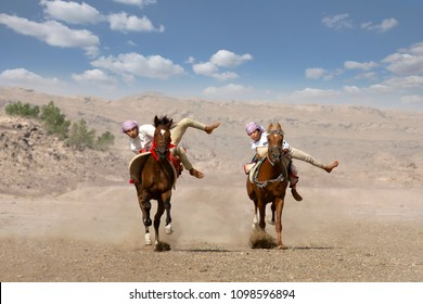 Al Safen, Oman, 28th April 2018: men riding horses for fun in rural Oman