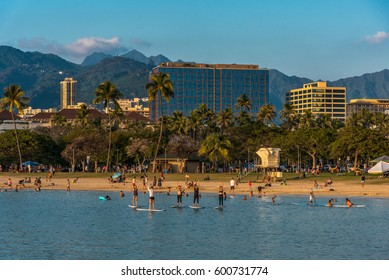 Ala Moana Beach Park, Hawaii - March 12, 2017: locals and tourists take a yoga surfing class at ala moana beach park, near waikiki and the ala moana shopping center