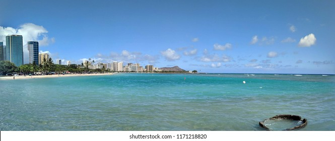 Ala Moana Beach Park with office building and condos in the background during a beautiful day on the island of Oahu, Hawaii. 2018