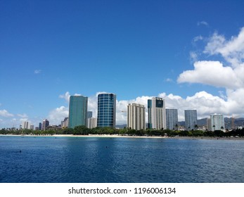 Ala Moana Beach Park with office building and condos in the background during a beautiful day on the island of Oahu, Hawaii. September 18, 2013.